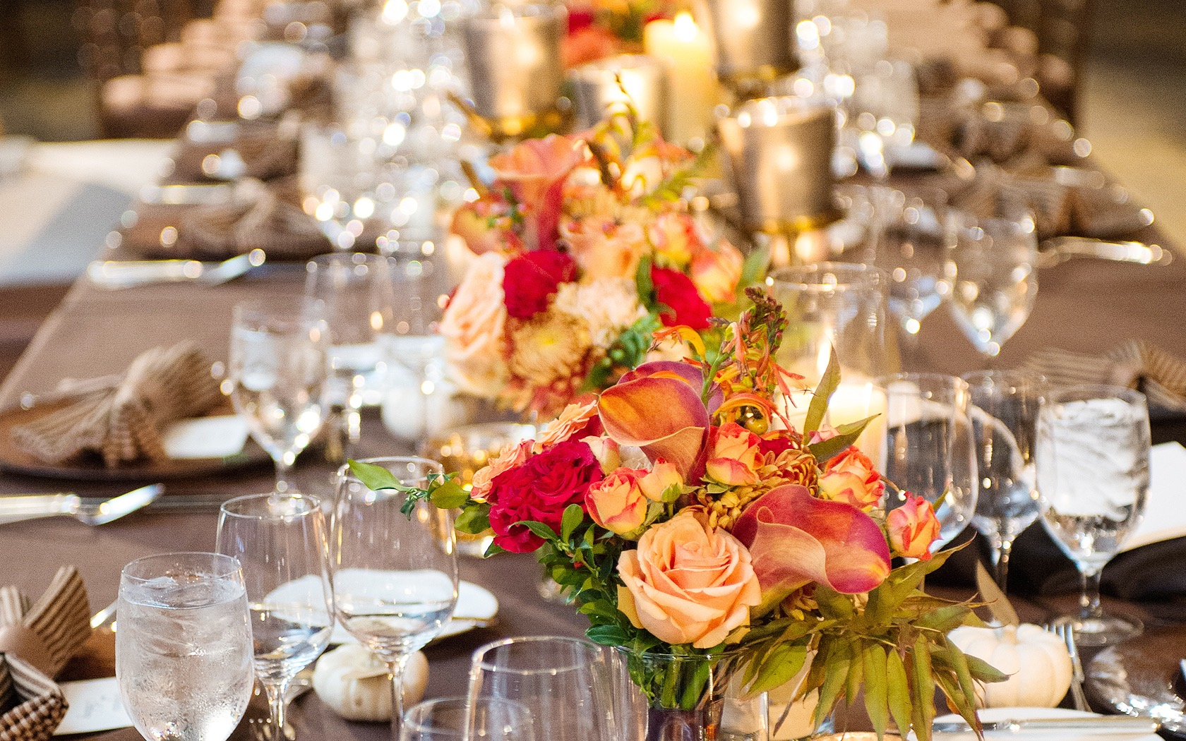 colorful red and orange roses on a table