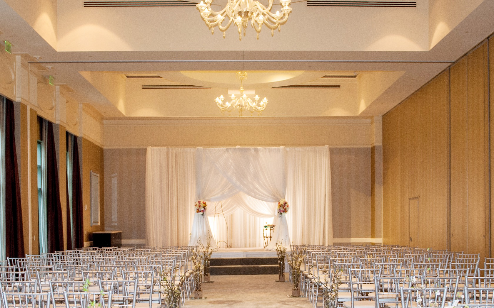 white chairs lined in front of a wedding alter