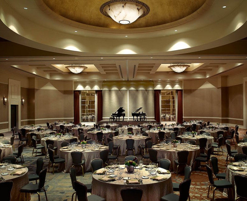 windsor ballroom arranged with large round tables and chairs under a dome ceiling