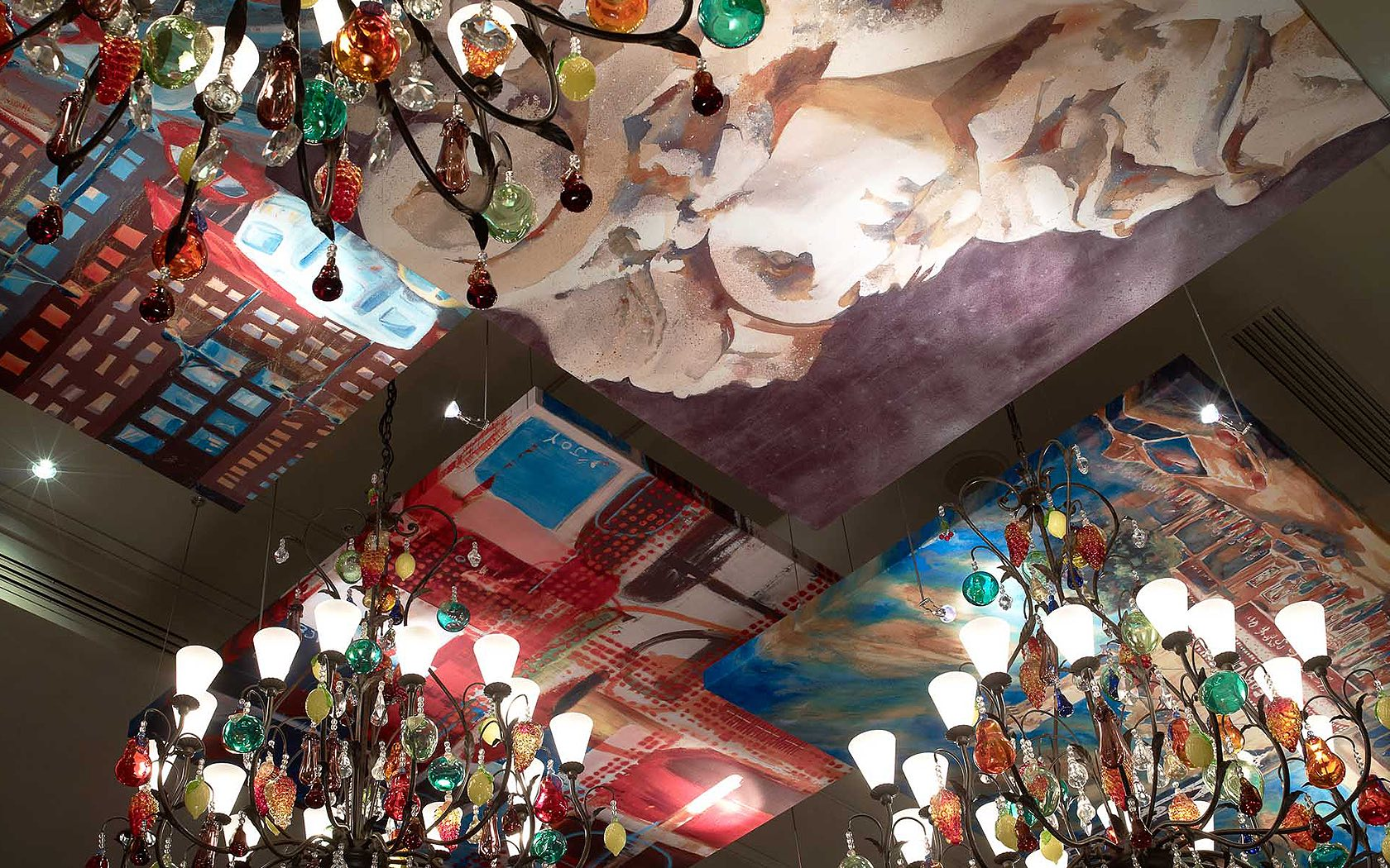restaurant ceiling with canvas art work and colorful glass lighting fixtures