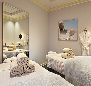 white massage table with towels in a treatment room