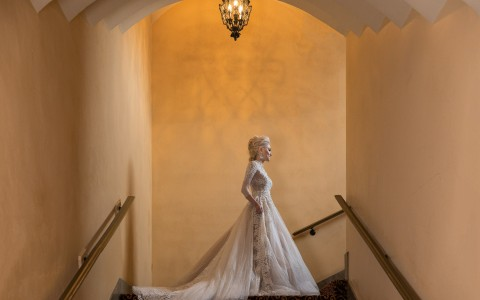 bride posing in a stairwell
