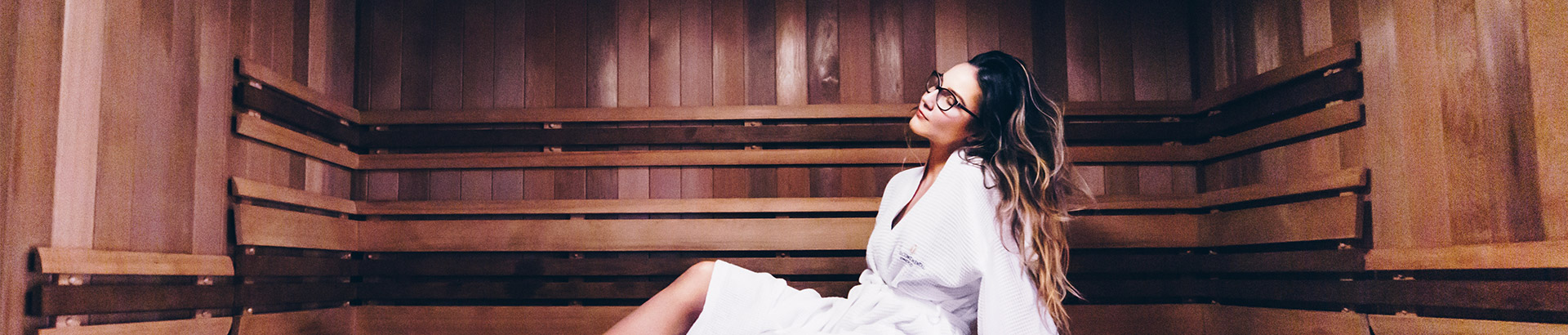 woman lounging in a sauna