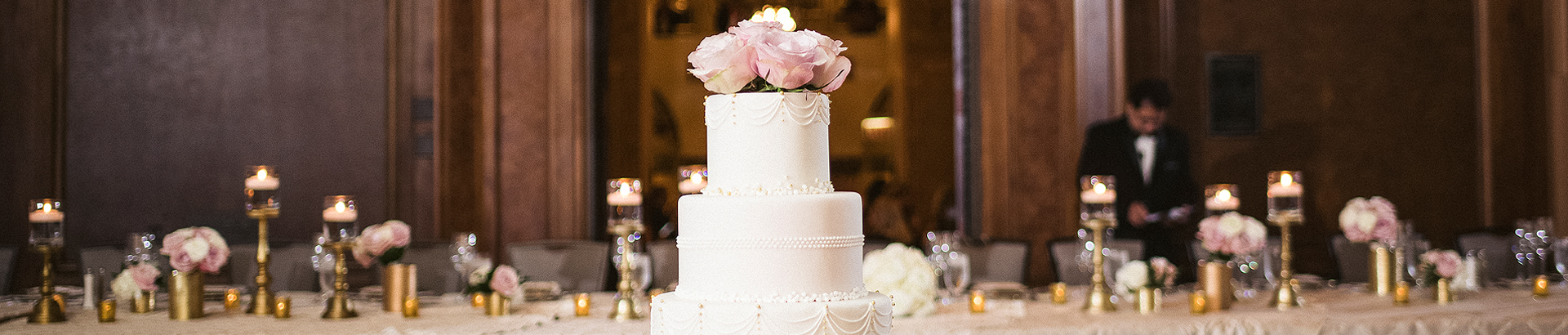 wedding cake in front of a large table