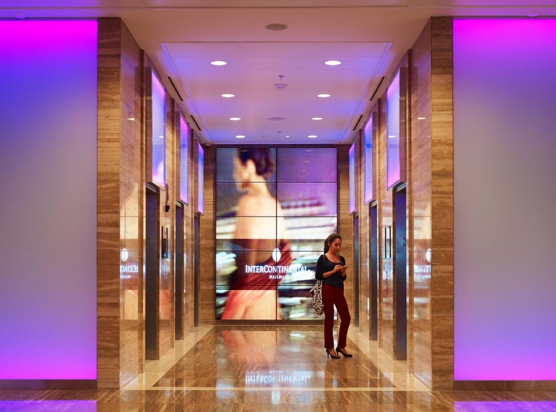 digital screens near lobby elevators
