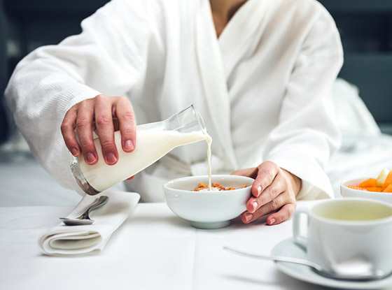 guest in bathrobe having room service