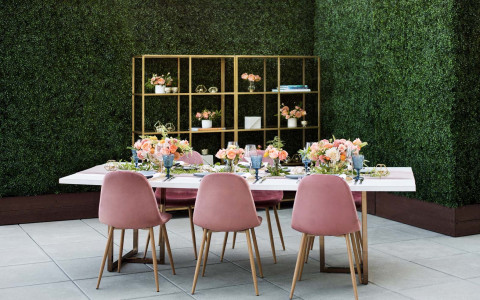 table with pink chairs and set up
