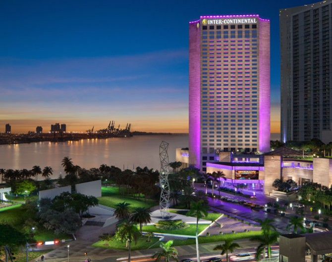 exterior of hotel in purple with water view