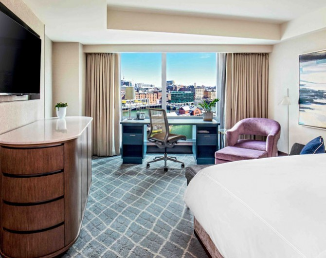 room with boston view and purple chair