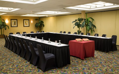 Meeting room with podium & tables set in U shaped fashion