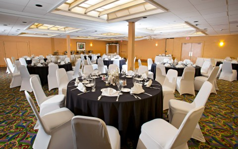 Event space with round tables set for meal