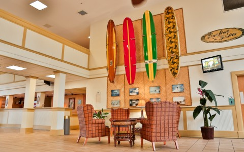 Hotel lobby with seating area & decorative surfboards on wall