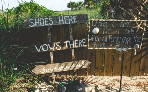 Drift wood sign reading shoes here & vows there