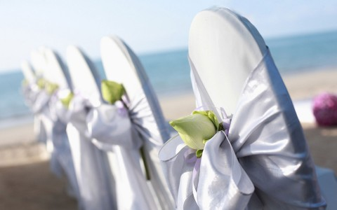 wedding chairs set up on the beach