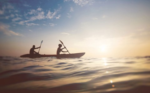 two people kayaking in the ocean
