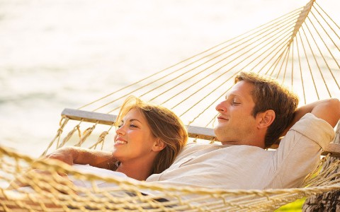 couple smiling on a hammock