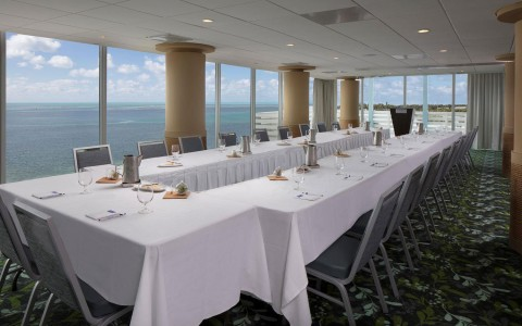 meeting space with a view of ocean and large table with white table cloth