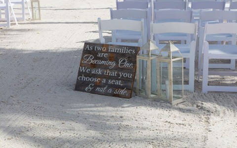 wood wedding sign by the sand