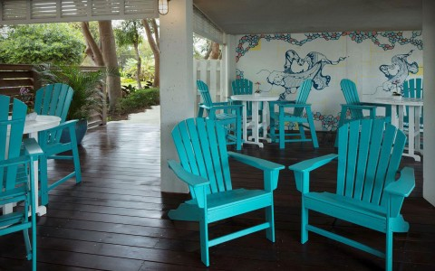 porch with teal chairs