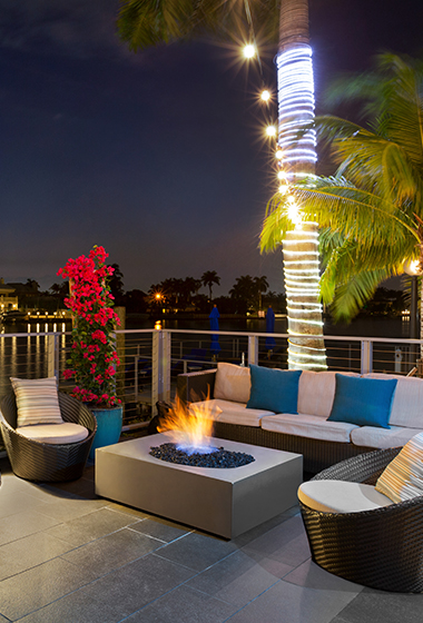rooftop lounge area with couches and fire pit