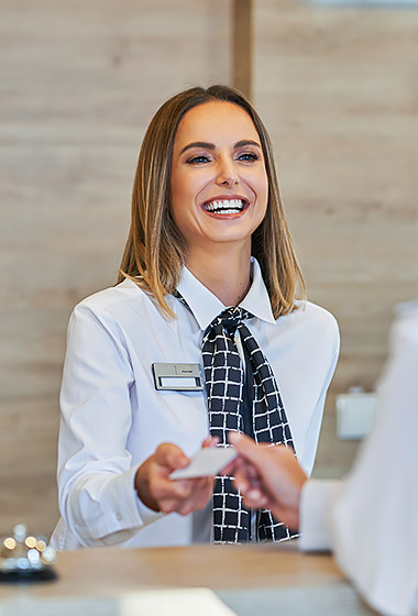 woman at front desk checking in guest