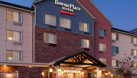 exterior of Townplace hotel with lights on at night