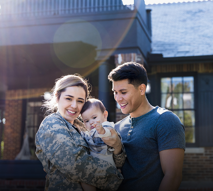 woman in the military hugging her family