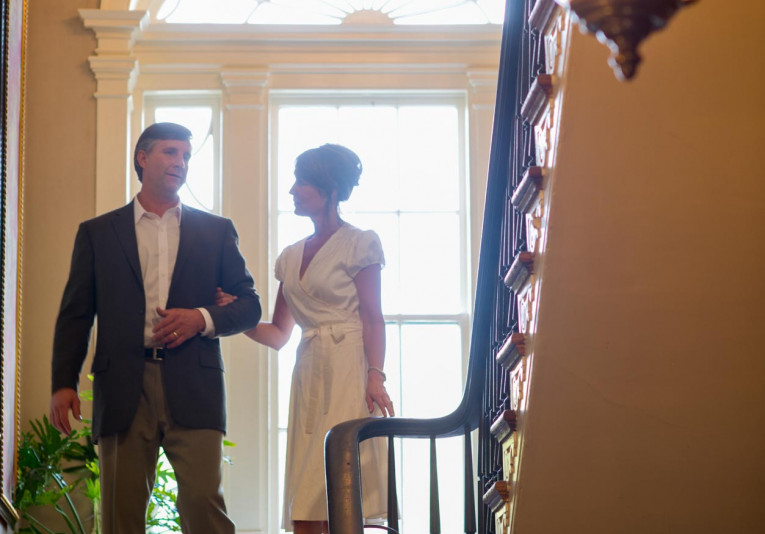 Couple walking into the lobby of John Rutledge House at then entrance of the grand staircase