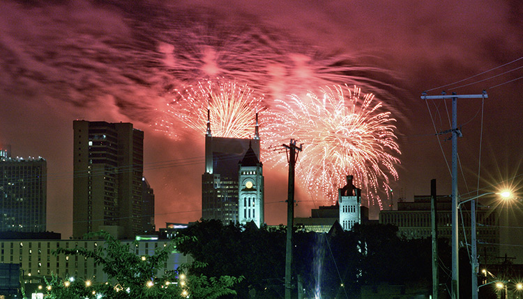 Buildings with fireworks in the background