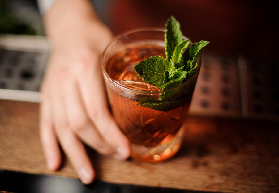 Cocktail on the rocks with mint leaves