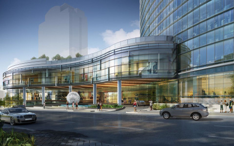 Rendering of cars driving by the front entrance of hotel
