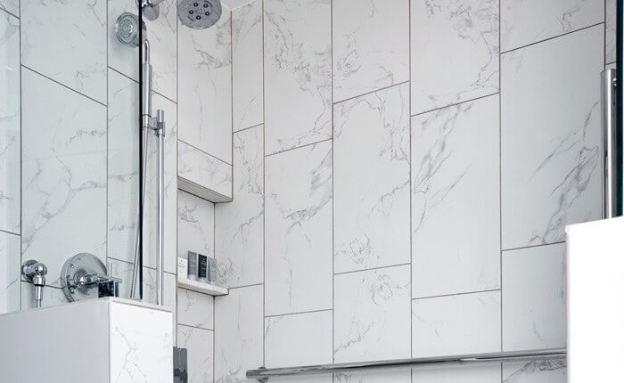 white marble walk in shower