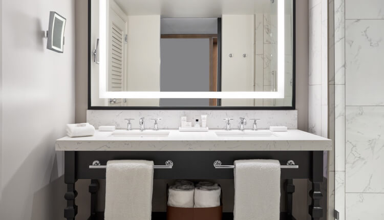 double sink bathroom vanity below mirror with lighted frame
