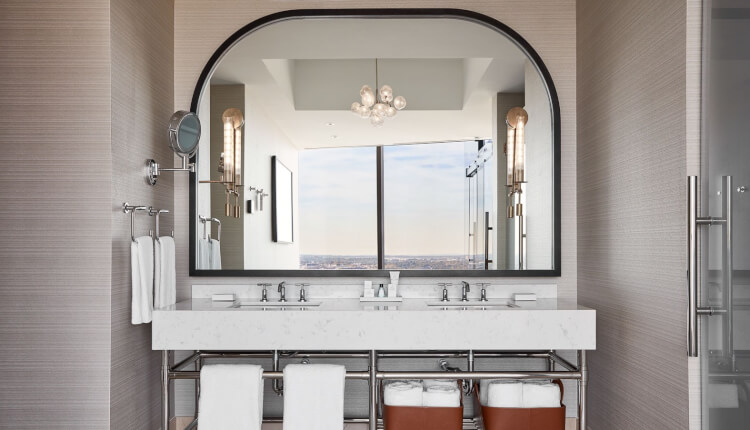 double sink vanity with arched mirror