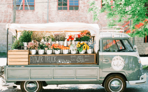Truck with potted flowers for sale