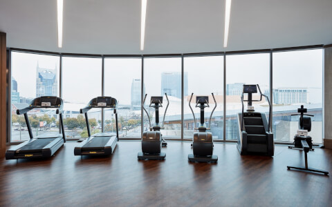 cardio machines lined up looking out towards nashville skyline