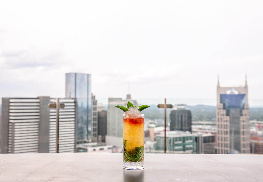 cocktail on table overlooking skyline