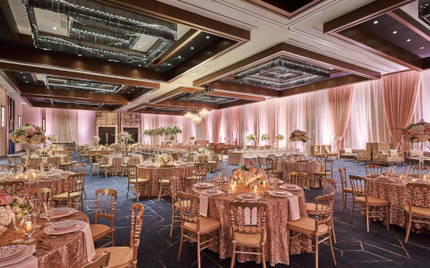 wedding event with pink table decor and walls