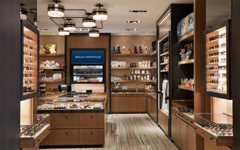 wider view of gift shop showing sunglasses and and island of other items in the middle
