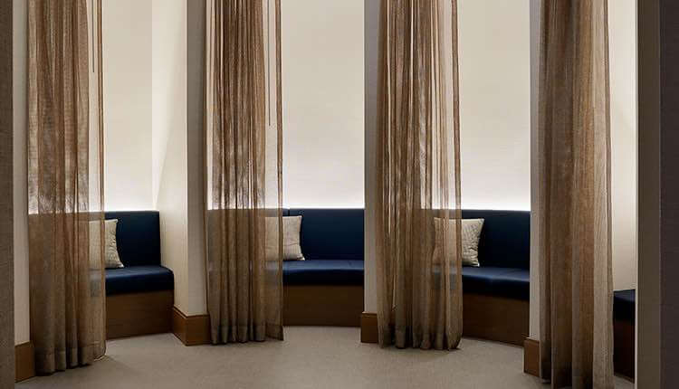 relaxation areas with comfortable seating and curtains