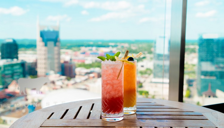 two cocktails on table overlooking skyline