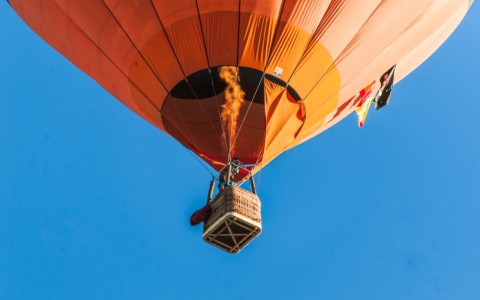 orange hot air balloon in blue sky