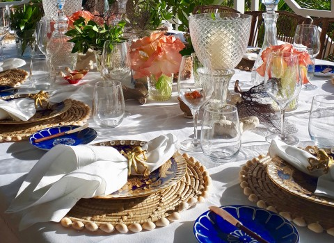 Table setting with glassware and colored plates