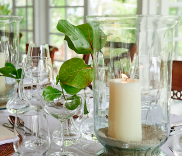 tabletop decor of candles and greenery
