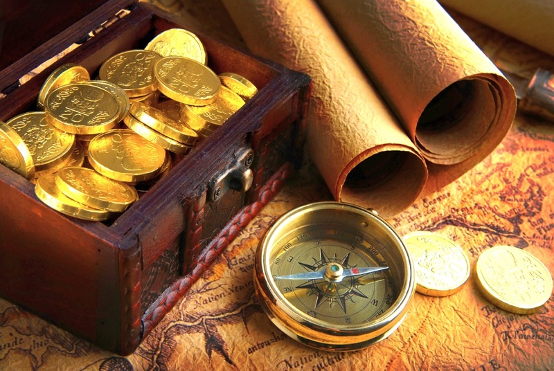 gold coins, treasure map and compass