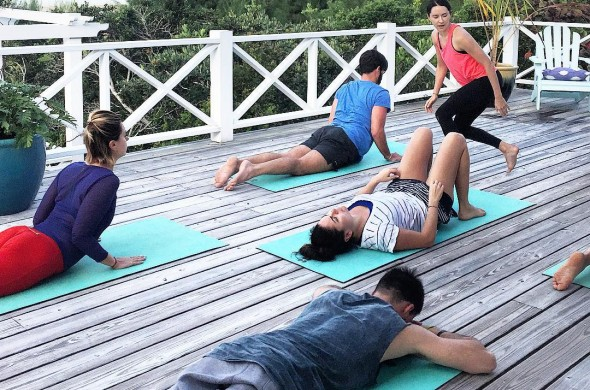 group yoga by the beach