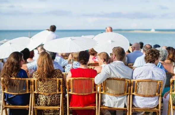 people sitting at a wedding ceremony