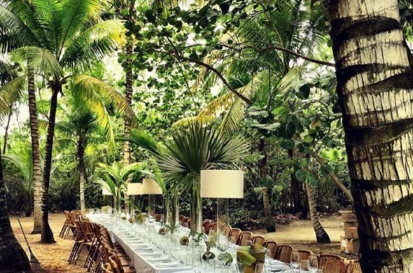 elegant table setting outside by palm trees