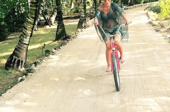 woman riding a bike down a path