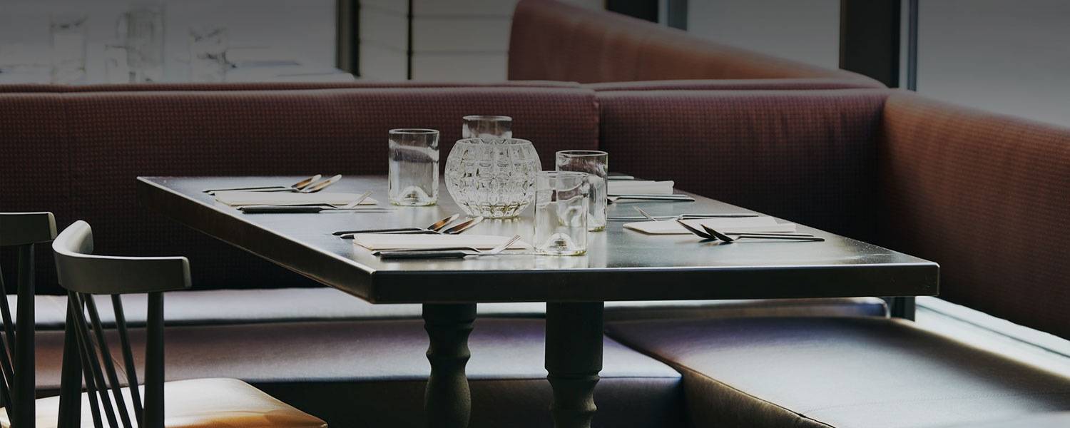 dining table with waters on table